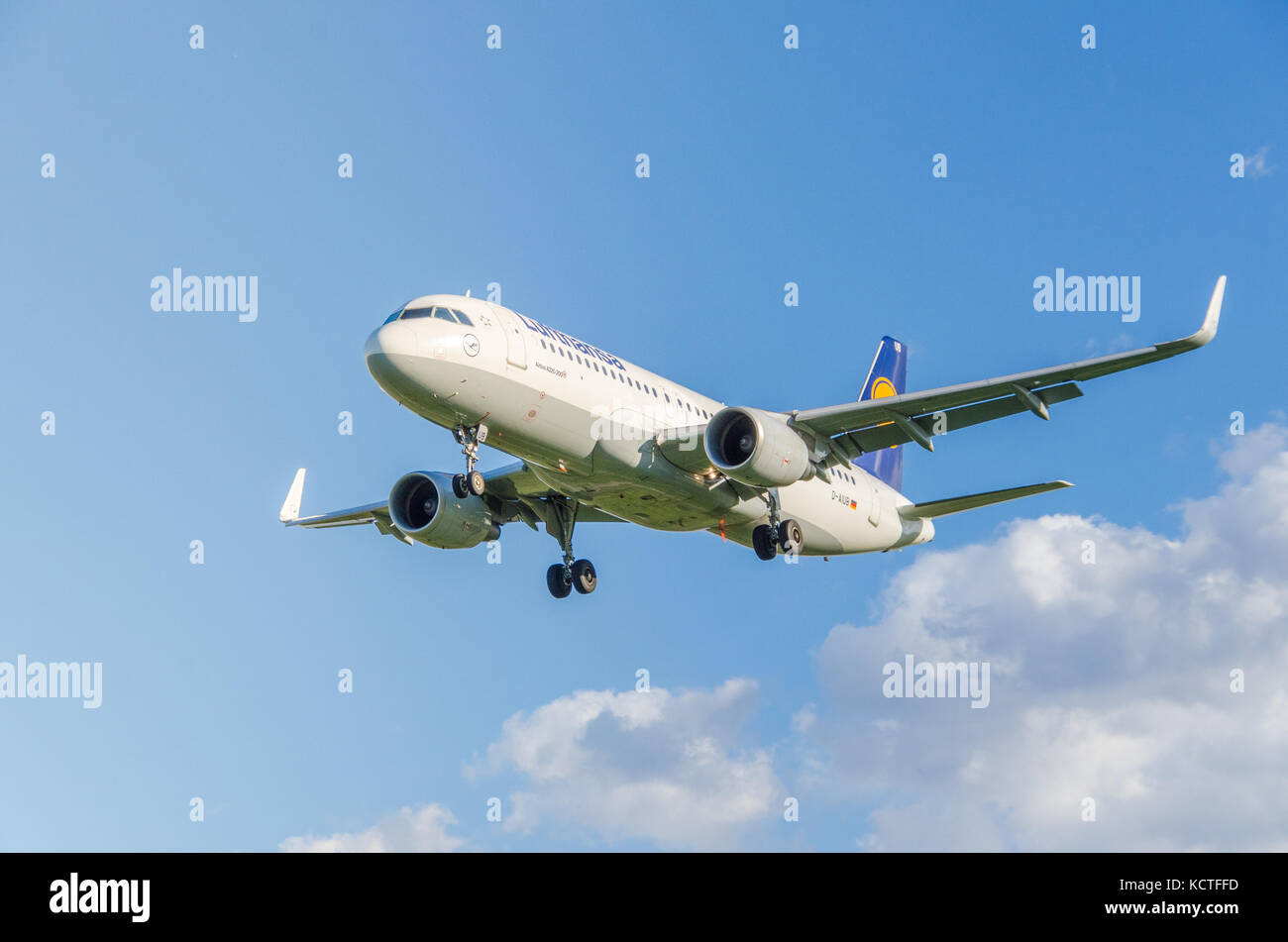 A Lufthansa Airbus A320-200  against a blue sky. These planes operate short-haul flights within Germany and Europe - Stock Image