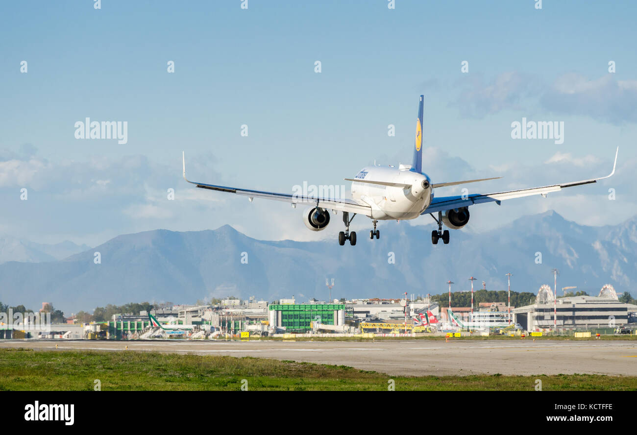 A Lufthansa Airbus A320-200  landing at Milan Linate Airport. These planes operate short-haul flights within Germany - Stock Image