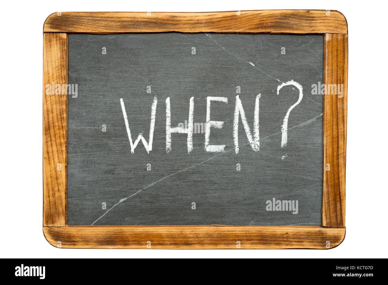 when question handwritten on vintage isolated slate chalkboard - Stock Image