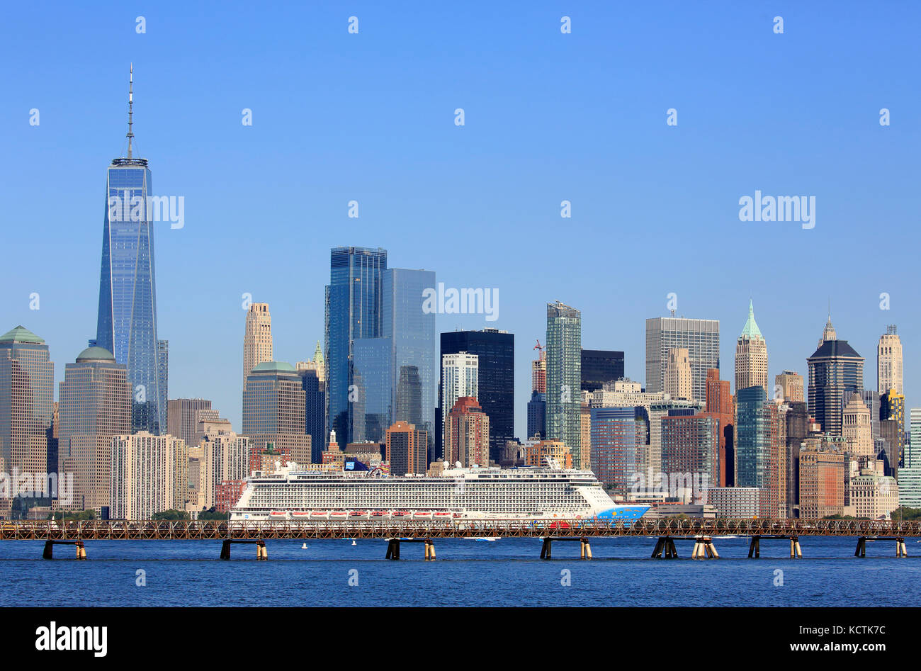 Norwegian Breakaway Cruise ship in Hudson River with the skyline of Lower Manhattan financial district in the background.New - Stock Image
