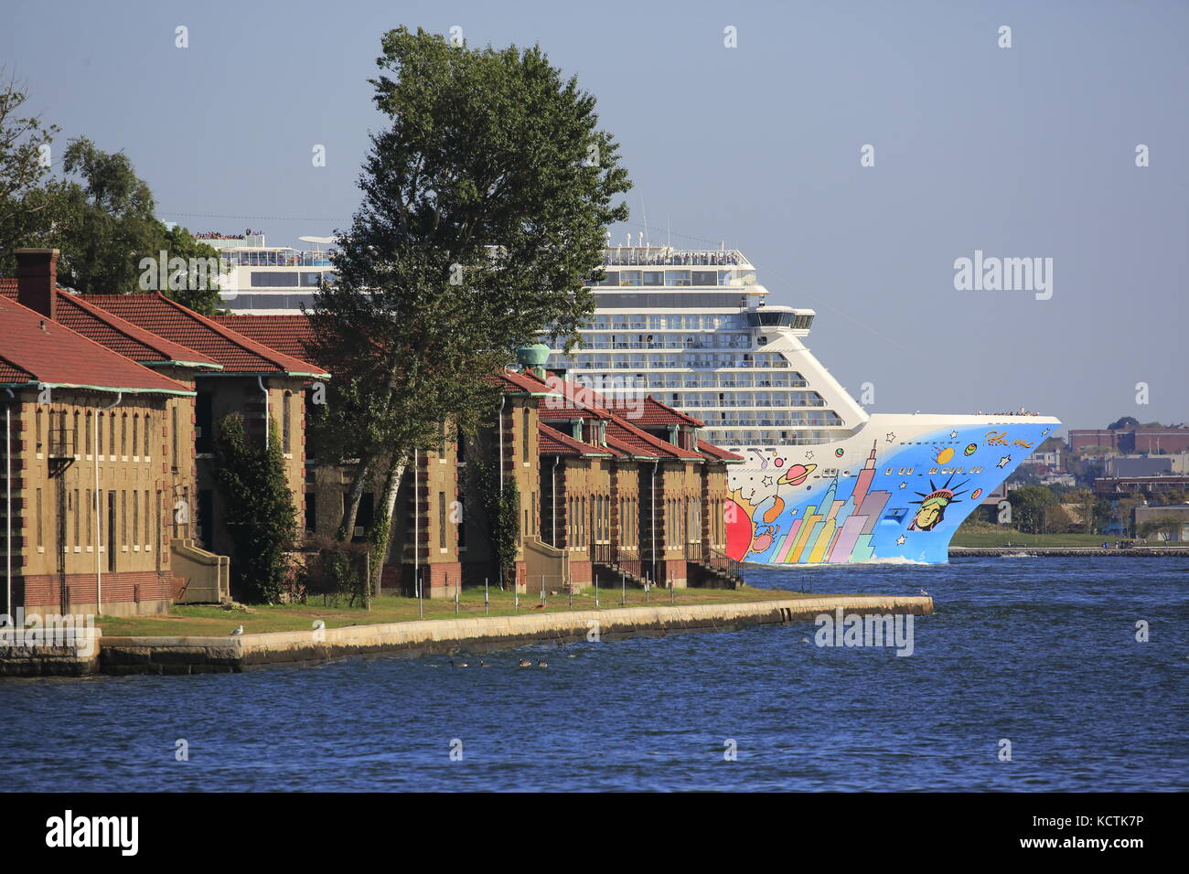 Norwegian Breakaway Cruise Ship in Hudson River with Ellis Island in foreground. New York City,New Jersey.New York.New - Stock Image