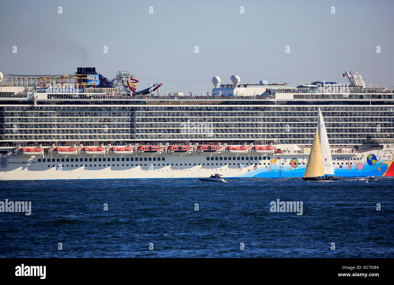 Norwegian Breakaway Cruise Ship in Hudson River with sailboat in foreground.New York City.USA - Stock Image
