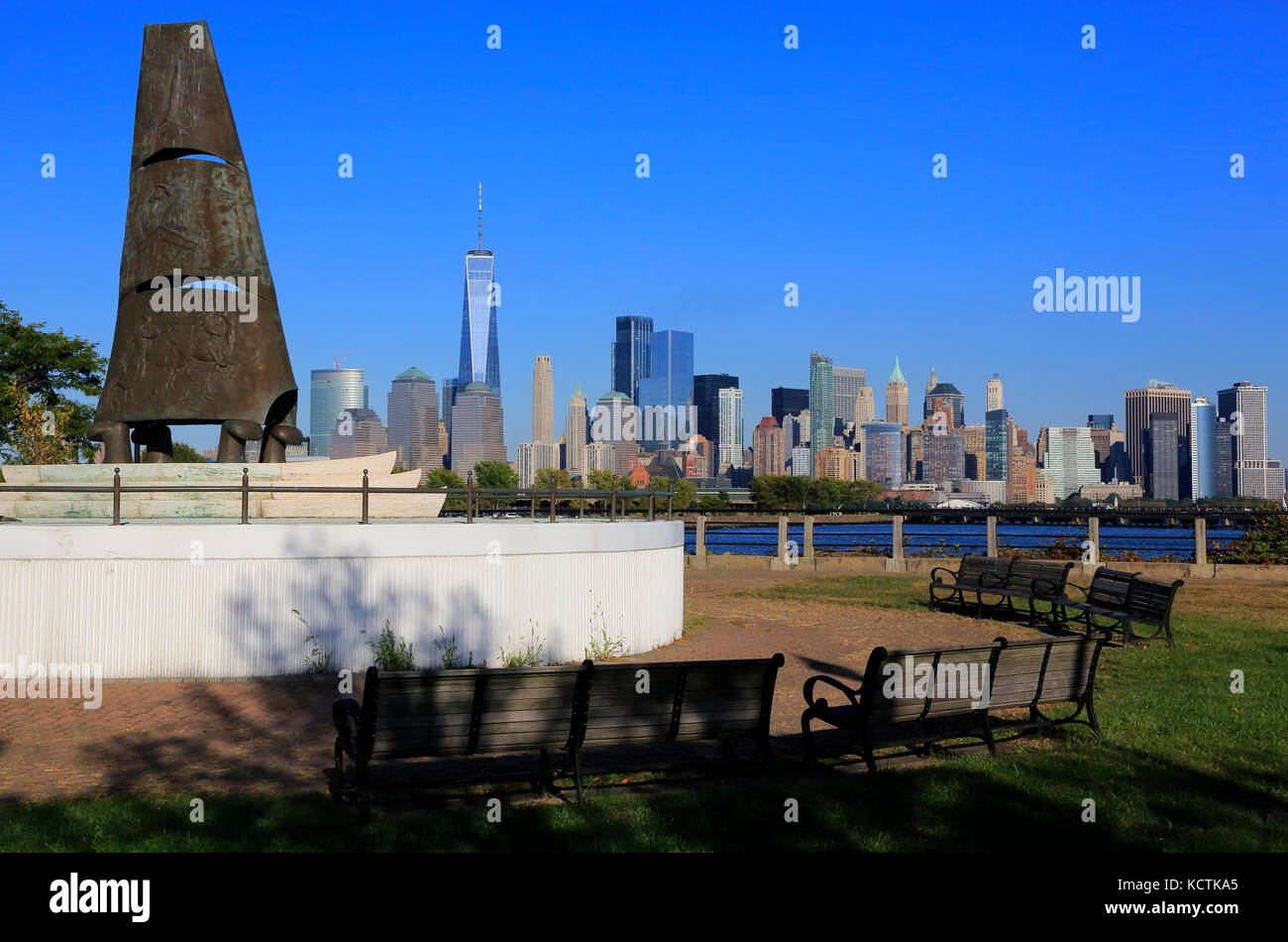 Columbus Monument at Liberty State Park in Jersey City with the view of skyline of Lower Manhattan in the background.New - Stock Image