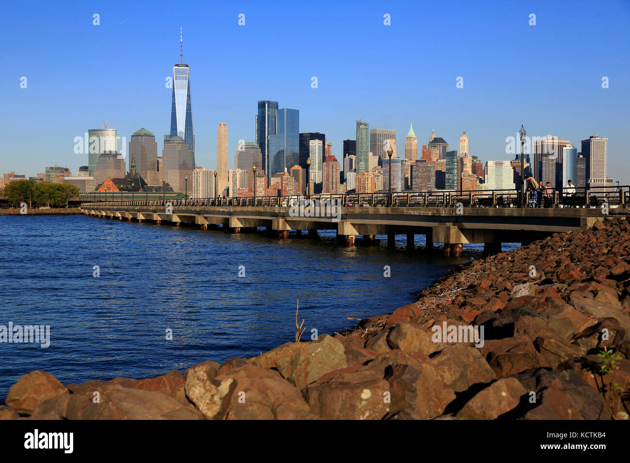 Skyline of Lower Manhattan with North Cove in foreground inside Liberty State Park. New Jersey.USA - Stock Image