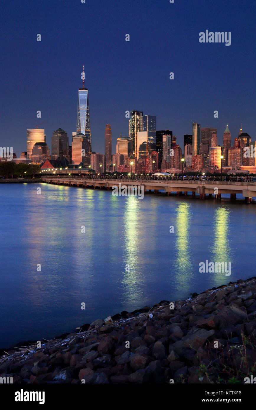 The night view of Lower Manhattan skyline with One World Trade Center tower in Financial District and Brooklyn.Manhattan,New - Stock Image