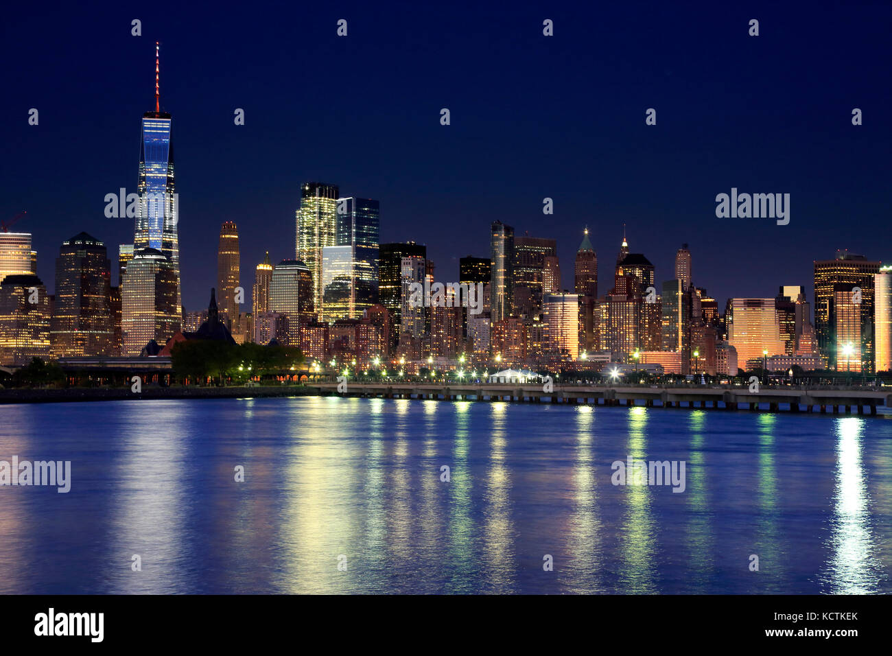 The night view of Lower Manhattan skyline with One World Trade Center tower in Financial Distric and Brooklyn.Manhattan,New - Stock Image