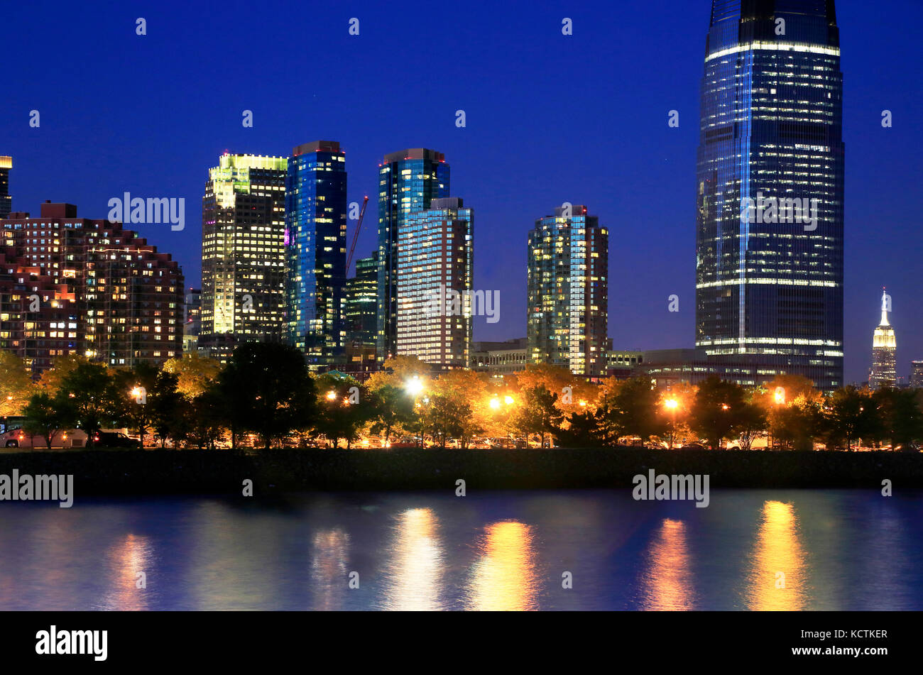 Night view of Jersey City skyline with Goldman Sachs &Co Tower and Manhattan skyline in the background.New Jersey.USA - Stock Image