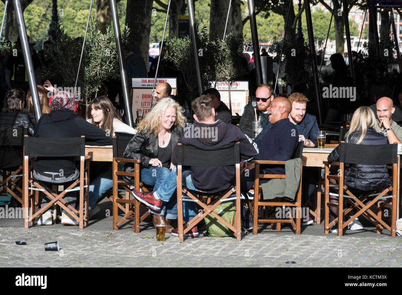 People socialising outside the British Film Institute at the South Bank Centre, London, UK - Stock Image