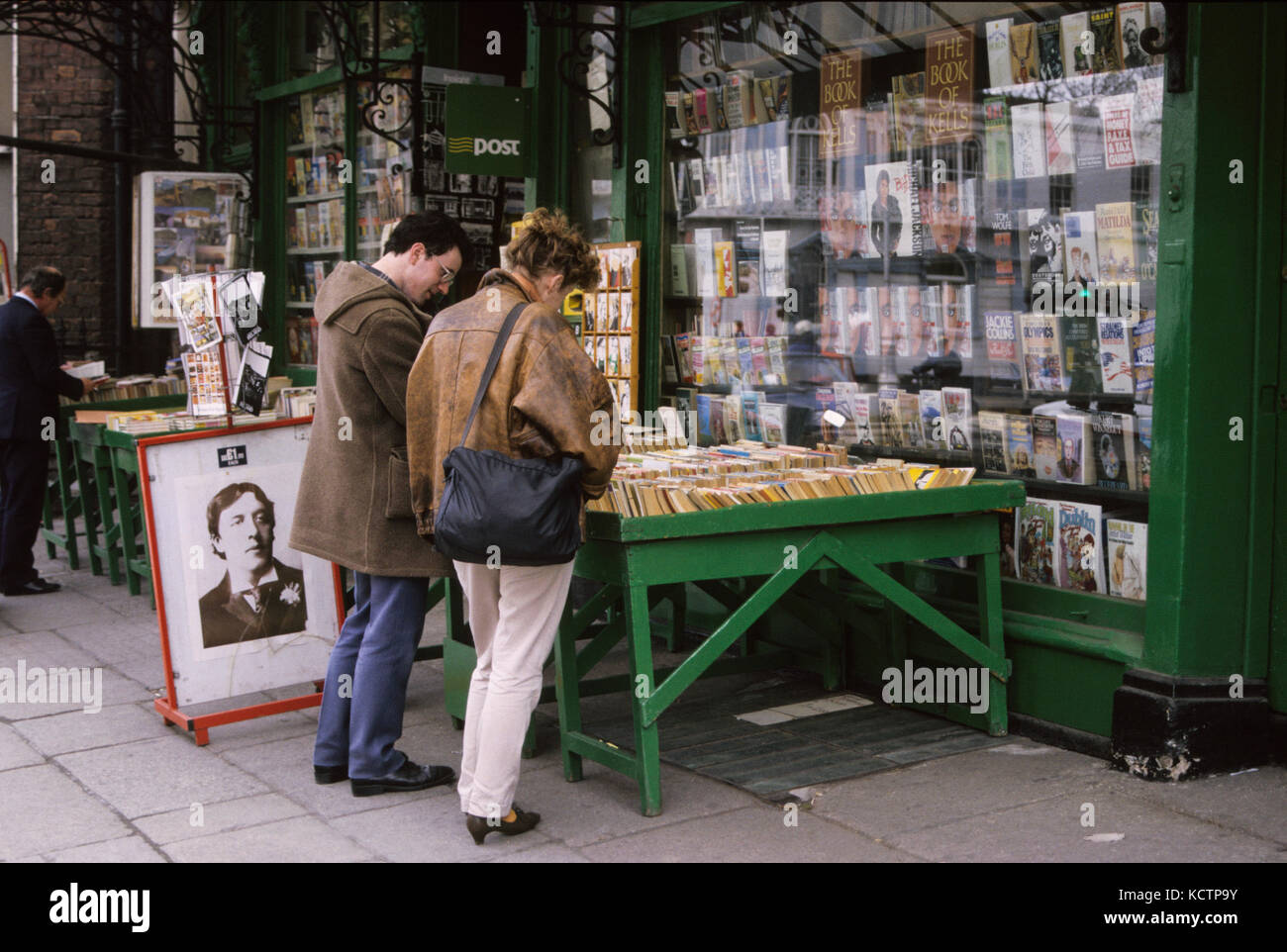 BOOKSTORE London with a couple looking among paperback outside the shop 2009 - Stock Image