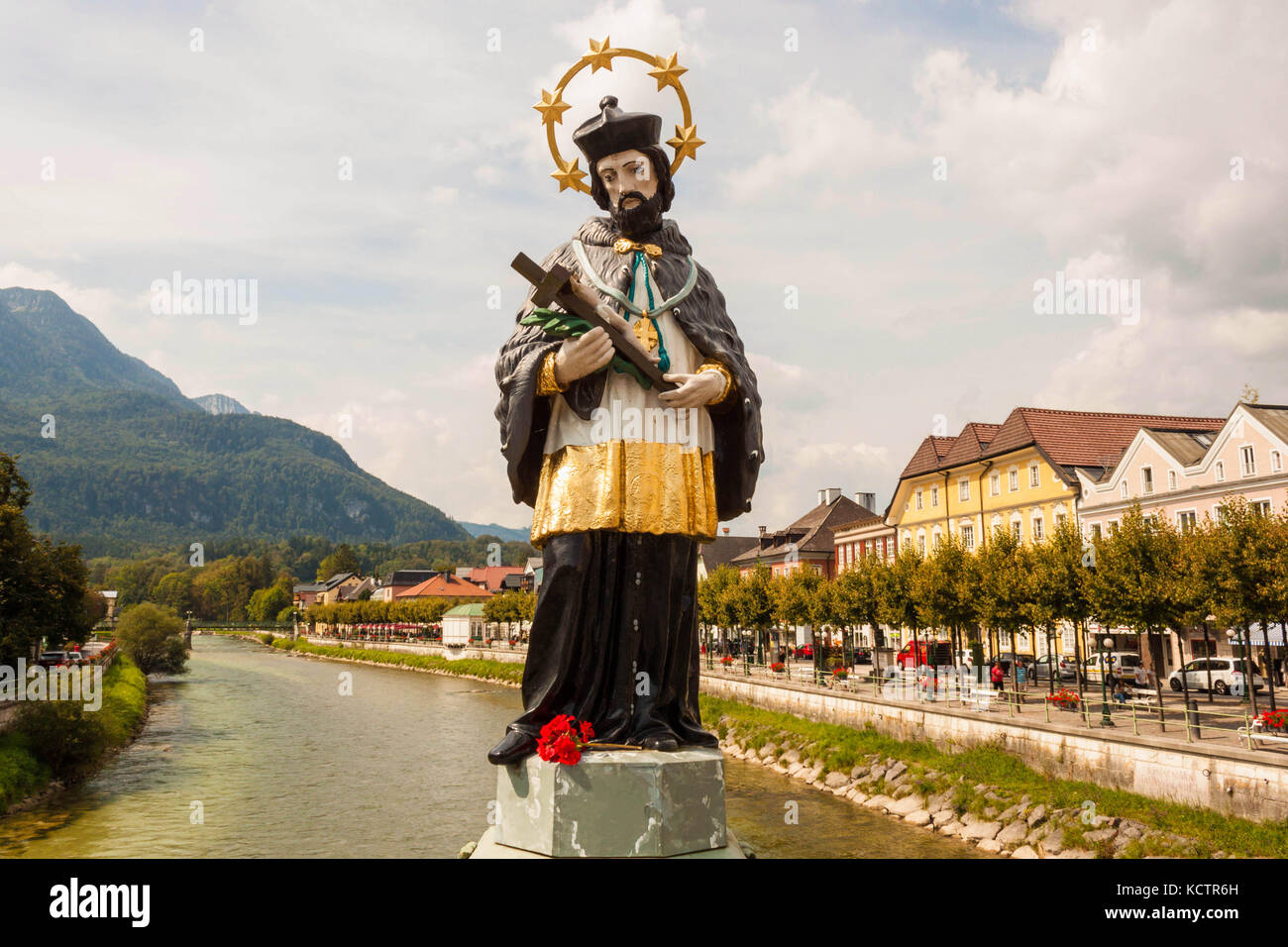 Painted statue of  John of Nepomuk on the Elisabethbridge over the Traun river in the resort town Bad Ischl, Austria - Stock Image