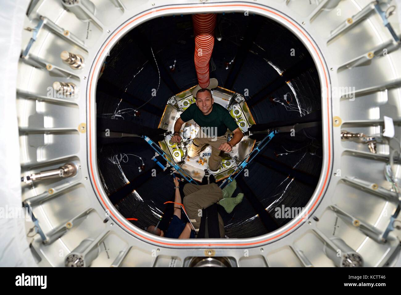 International Space Station Expedition 53 American astronaut Jack Fischer inspects the interior of the BEAM module - Stock Image