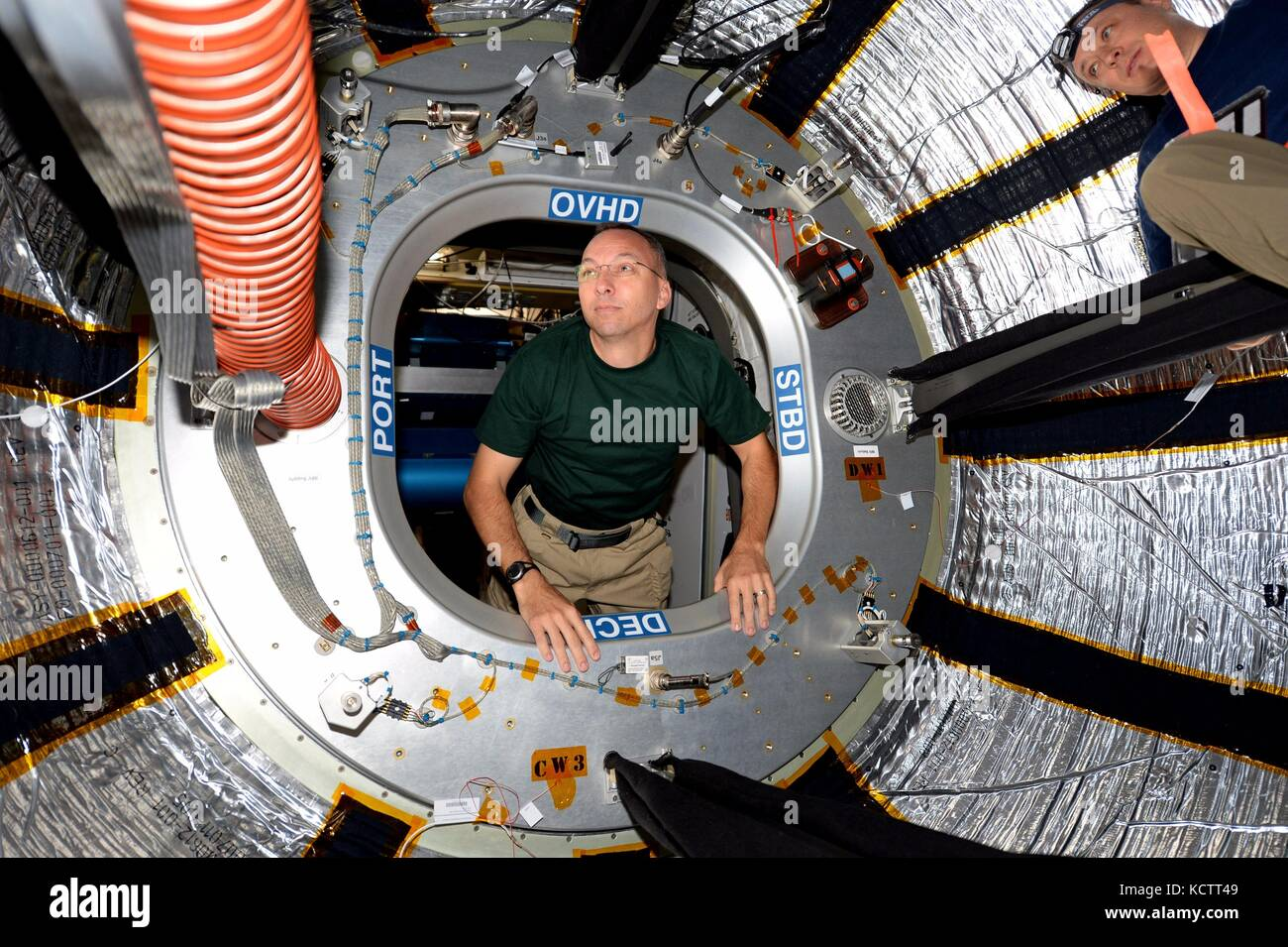 International Space Station Expedition 53 American astronaut Randy Bresnik enters the interior of the BEAM module - Stock Image