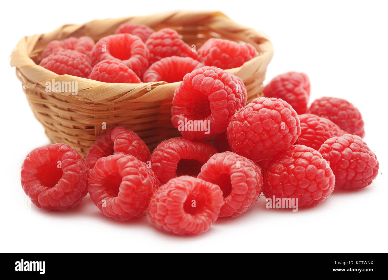 Fresh Raspberry in a basket over white background - Stock Image