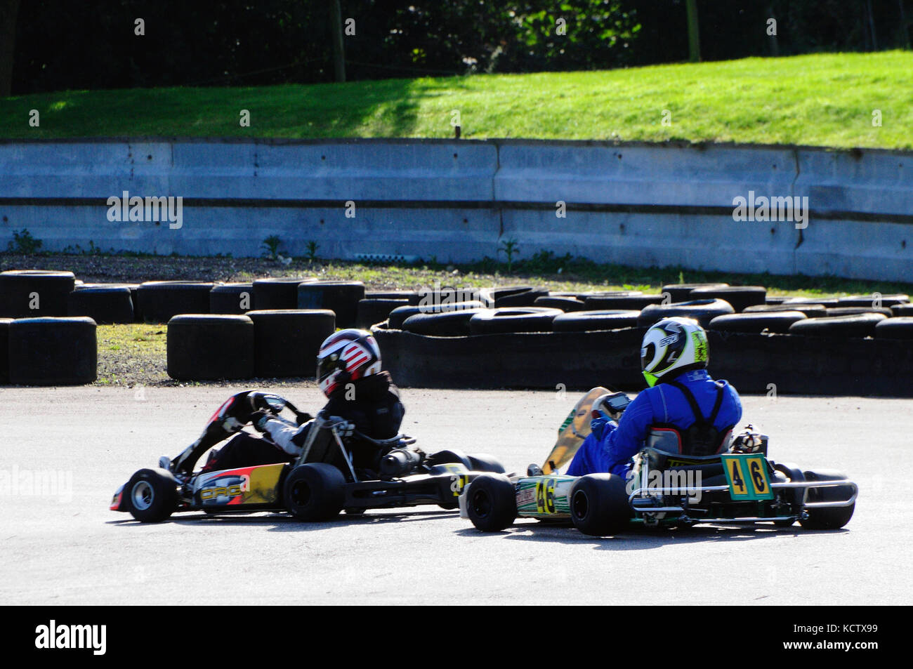 Go karting around a race track - Stock Image