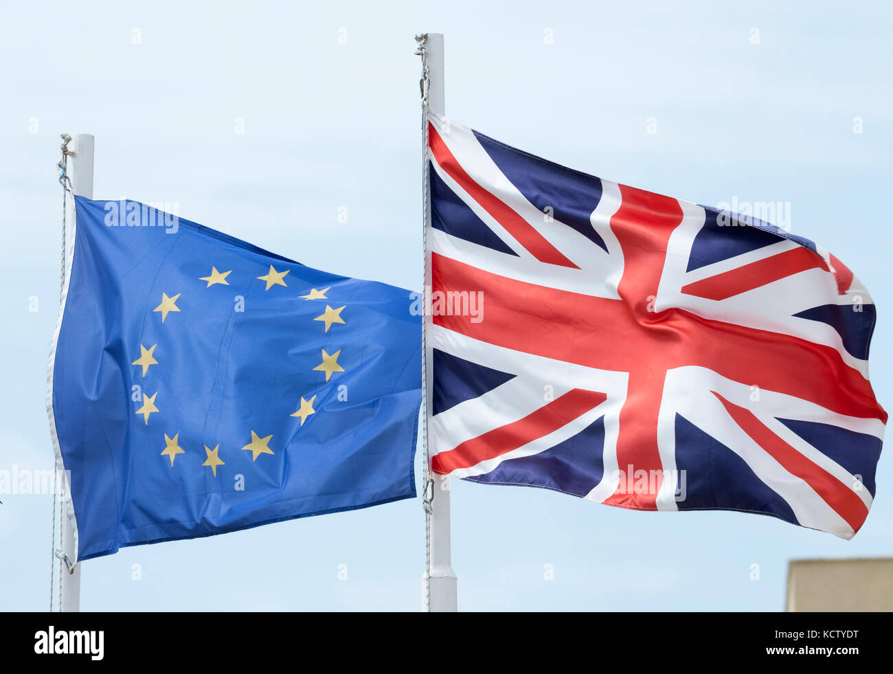 The European Union and British (Union Jack)  flags fly side by side in Cyprus. - Stock Image