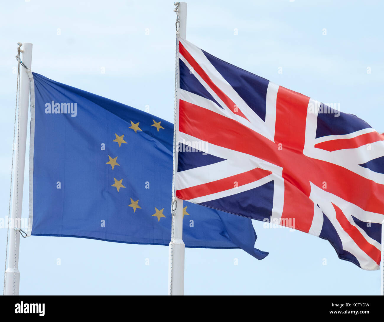The European Union and British (Union Jack)  flags fly side by side in Cyprus. Stock Photo