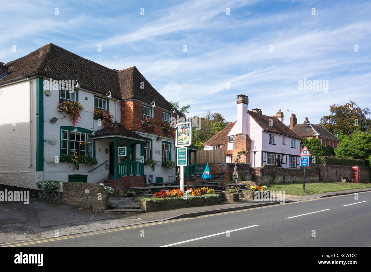 View of the high street and the Jolly Farmer pub in the village of Bramley, Surrey, UK - Stock Image