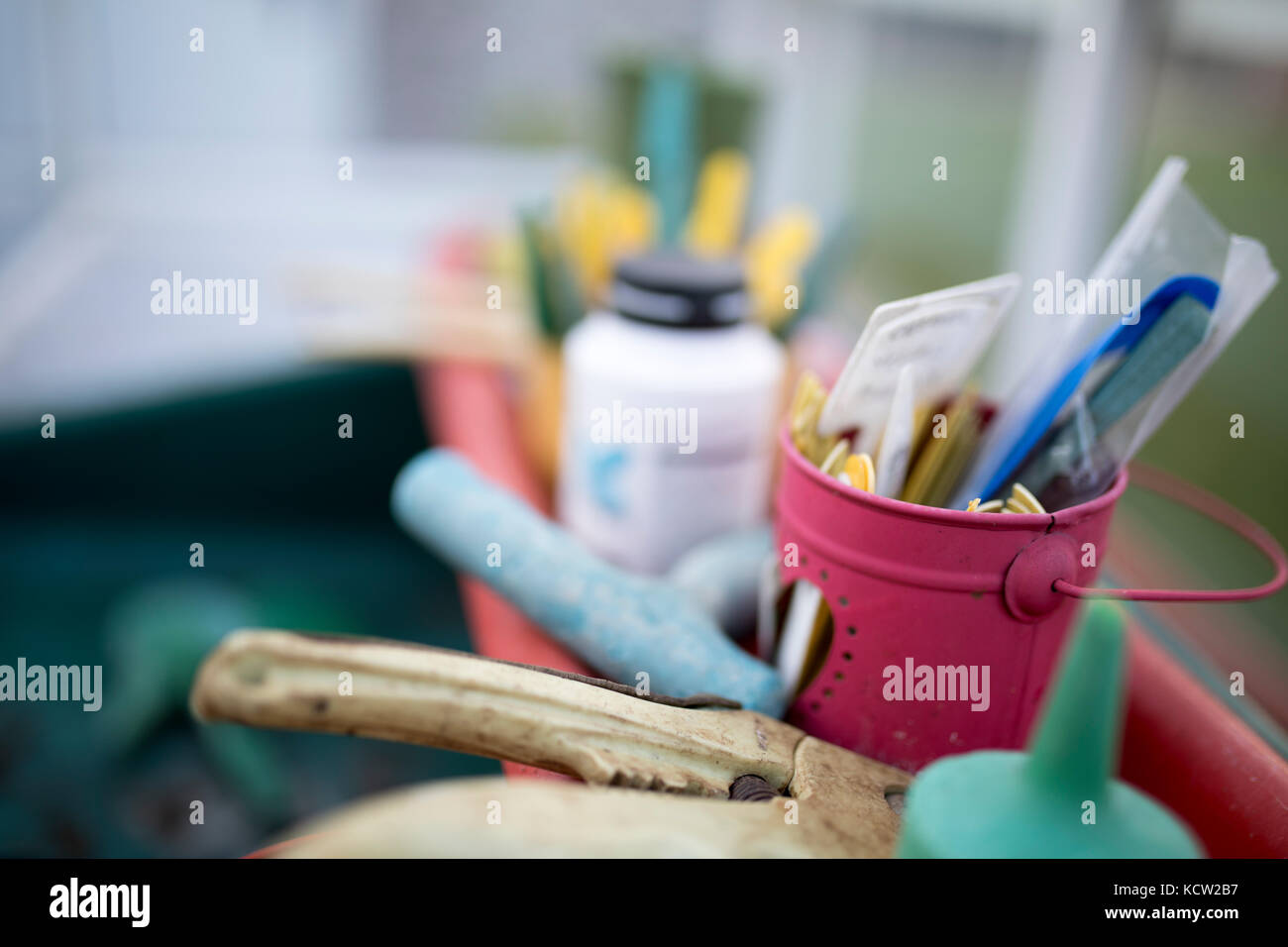 Close up of flower pot and tools in a green house or potting shed - Stock Image