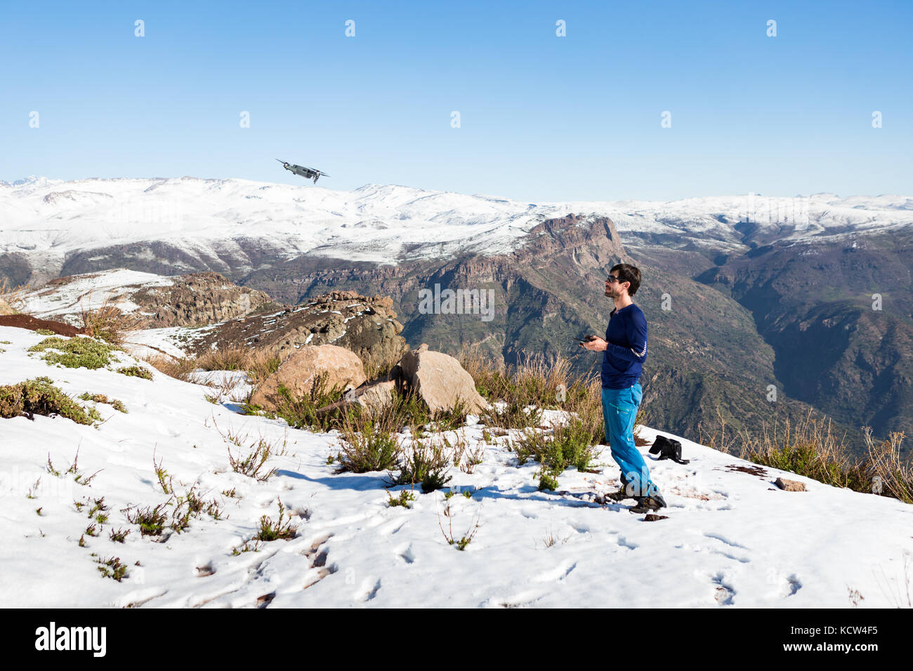 A man playing with DJI Mavic Pro drone Stock Photo