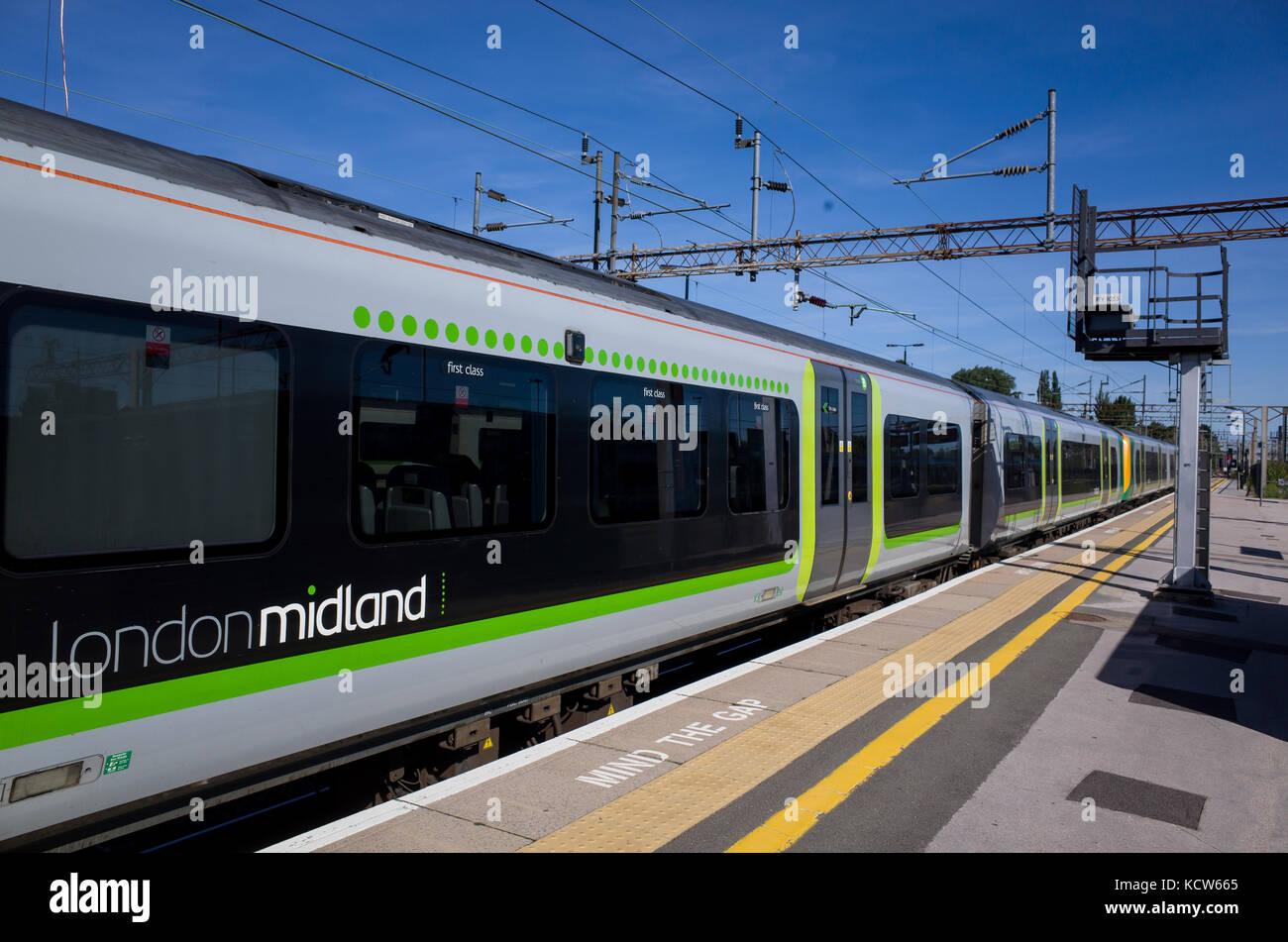 A London Midland train waits at the platform of Northampton Railway Station. Stock Photo