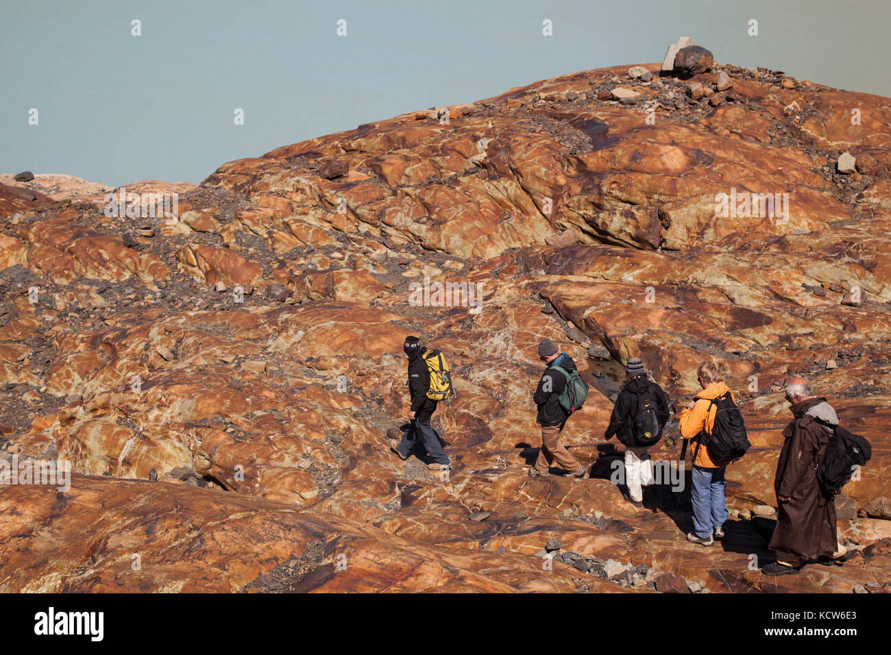 Group of hikers on striated rocks on the Viedma Glacier, Southern Patagonian Ice Field, Los Glaciares National Park, - Stock Image