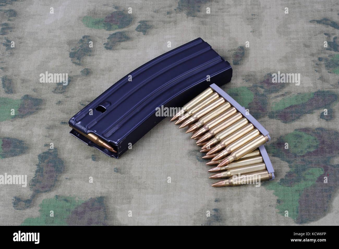 Ammunition with magazine on camoflage background Stock Photo