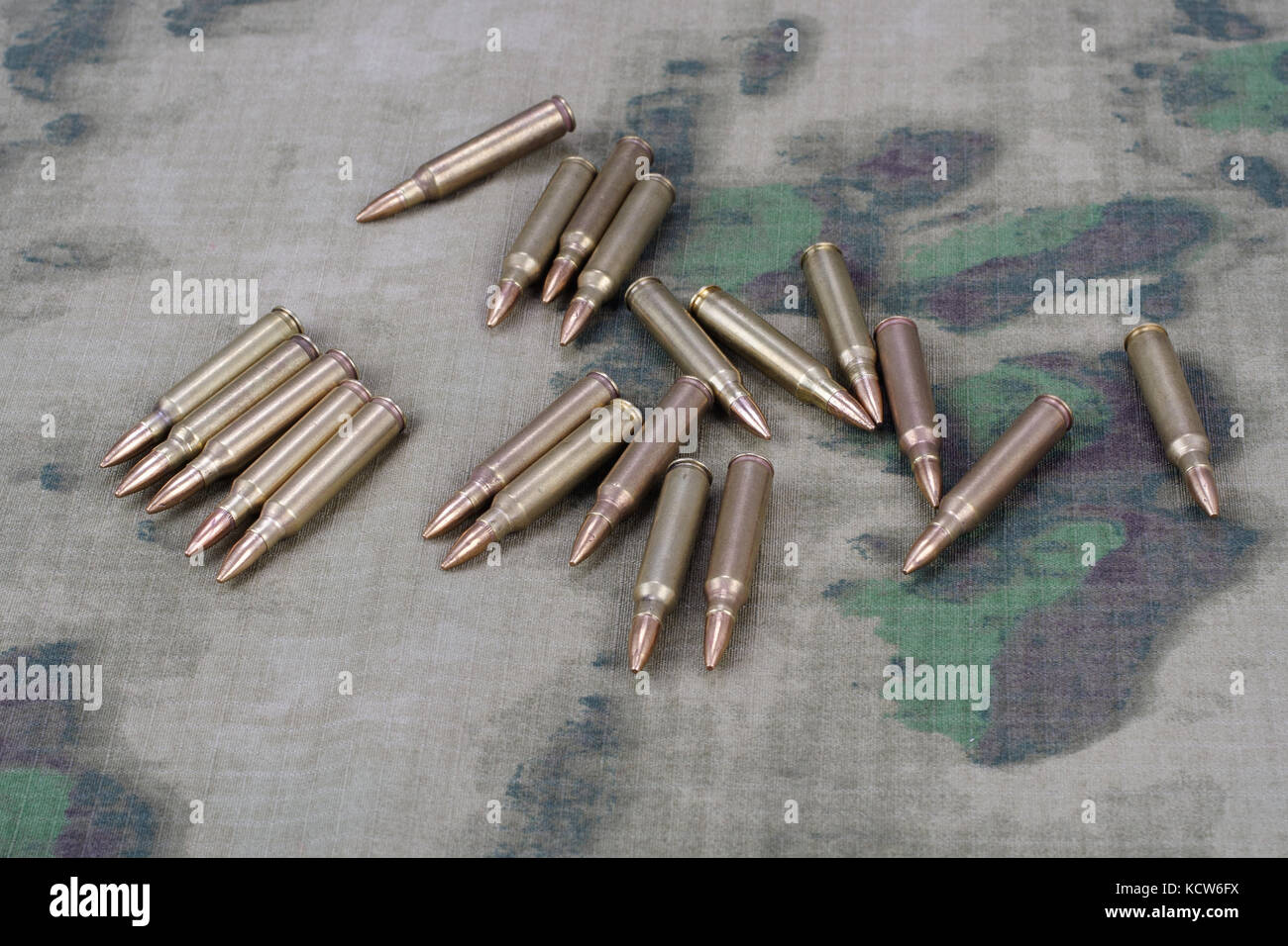 Ammunition on camoflage background Stock Photo