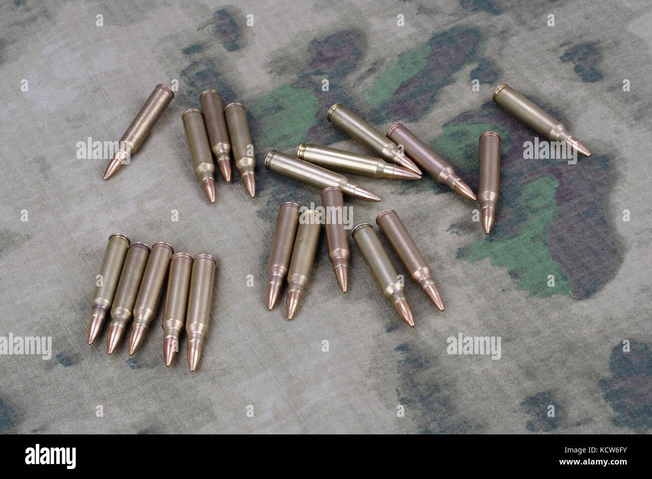 Ammunition on camoflage background - Stock Image
