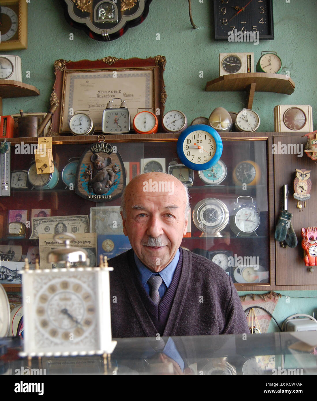 picture of a Old clockmaker posing in his workshop Jan22.2011, Resen, Macedonia - Stock Image