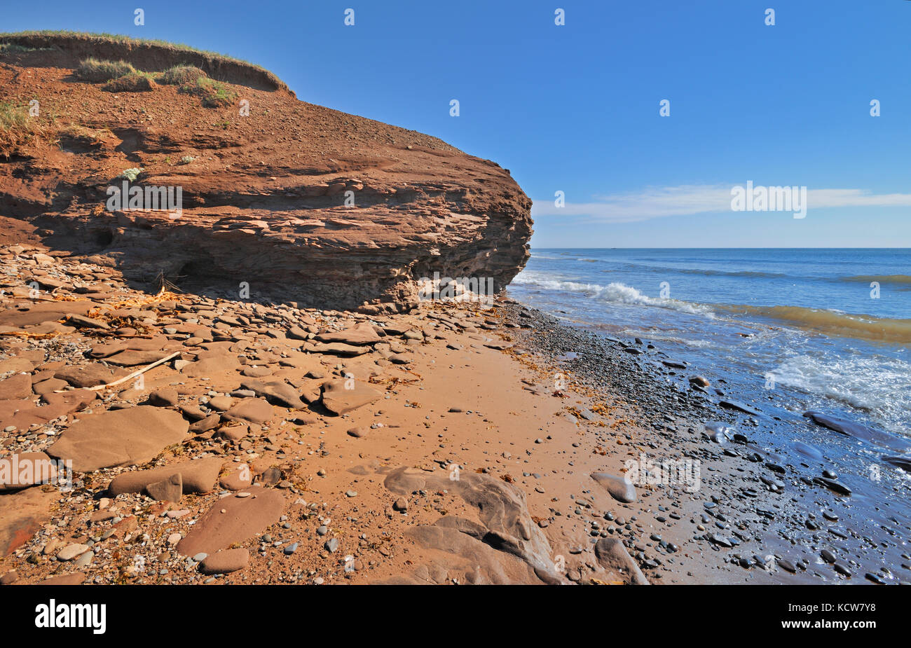 Waves lapping up on a beach, Lamèque Island, New Brunswick, Canada - Stock Image