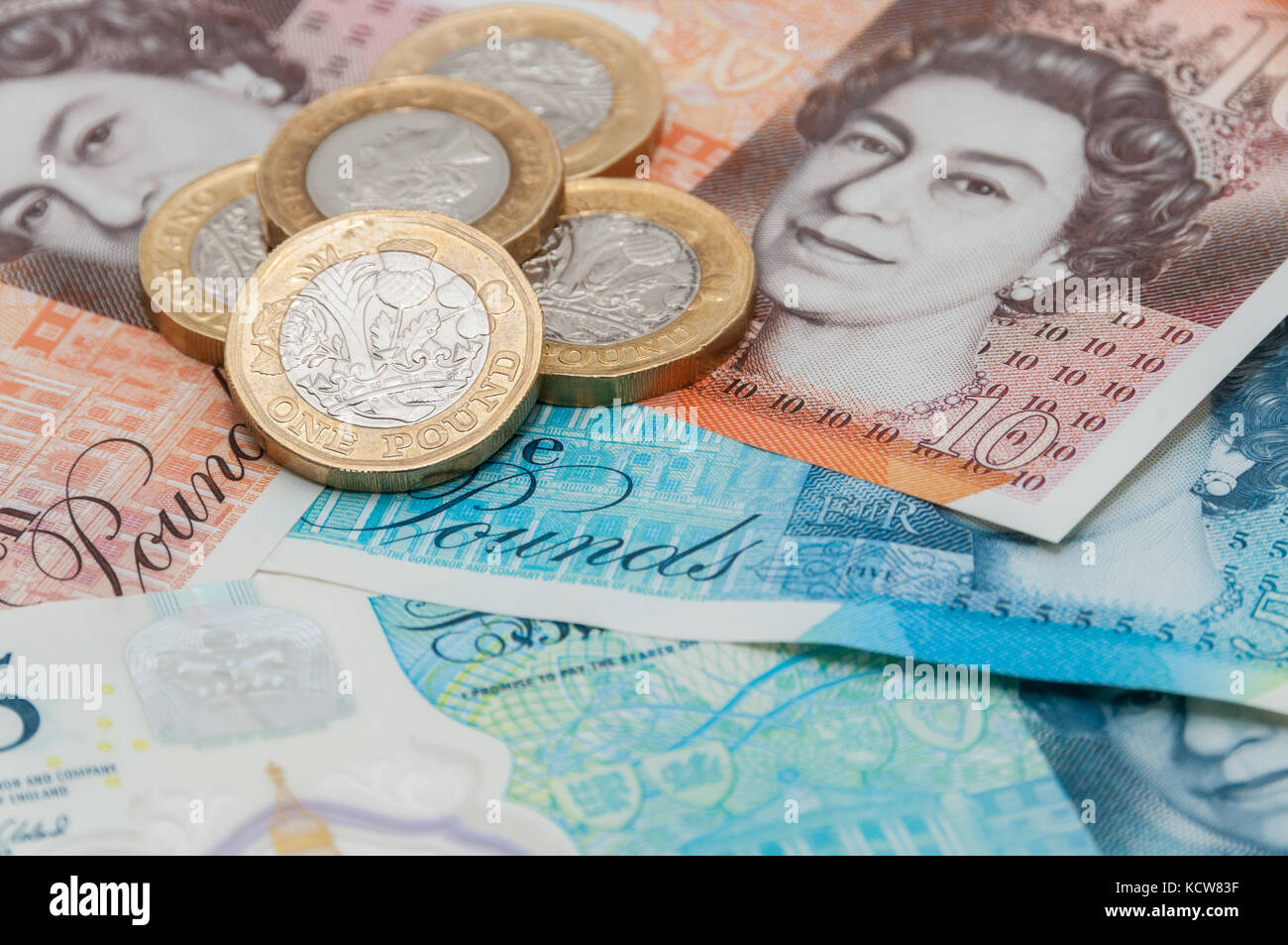 New UK currency, 10 pounds, 5 ponds, 1 pound coins Stock Photo