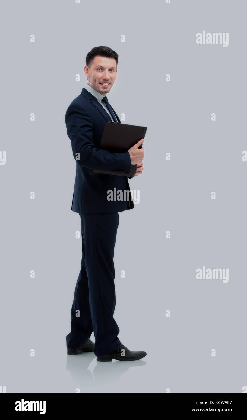 Businessman from the back - looking at you over a white backgrou - Stock Image