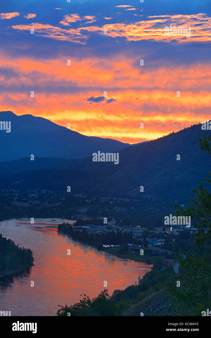 Sunset reflecting off the Columbia River in the Columbia Valley flanked by the Monashee Mountains in the West and - Stock Image