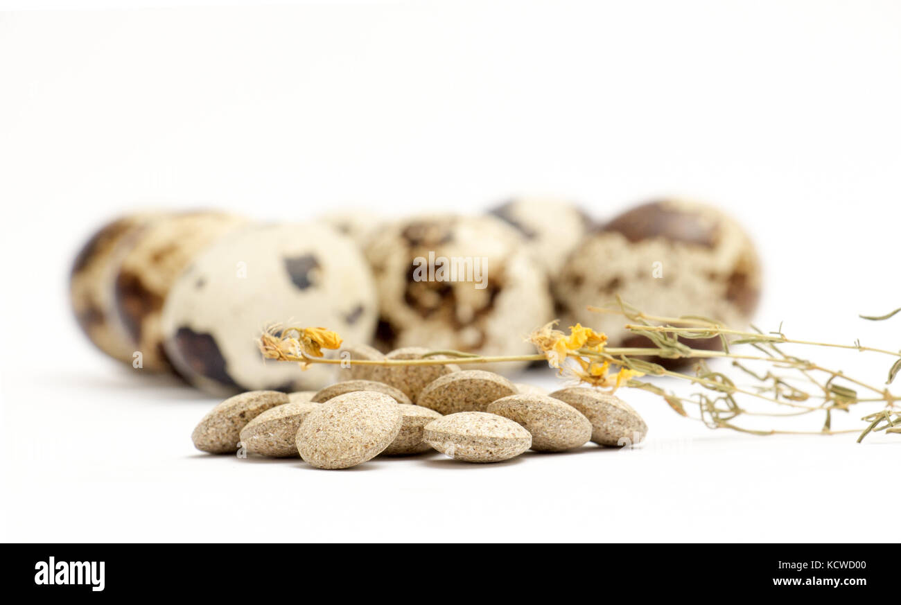picture of a japanese quail eggs and herbal pills - Stock Image