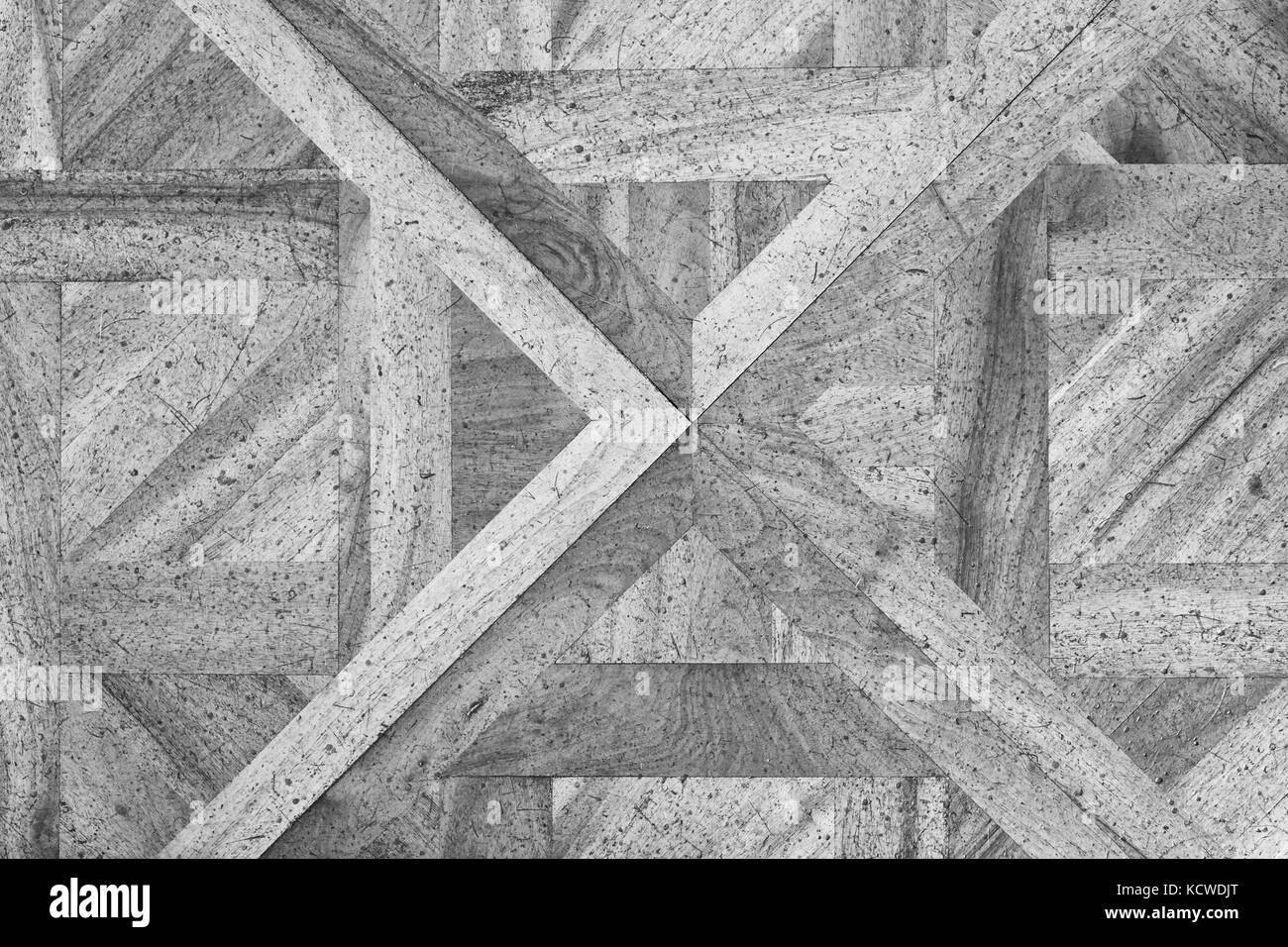 Worn out wooden floor of castle hall. Light wood flooring worn by use with defect - Stock Image