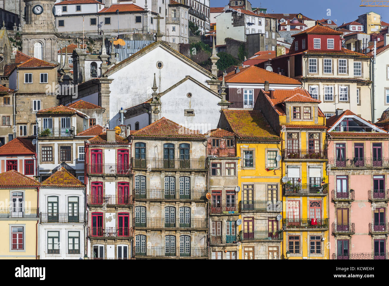 Row of buildings on the Douro riverfront in Porto city, Portugal. View with Parish Church of Saint Nicholas - Stock Image