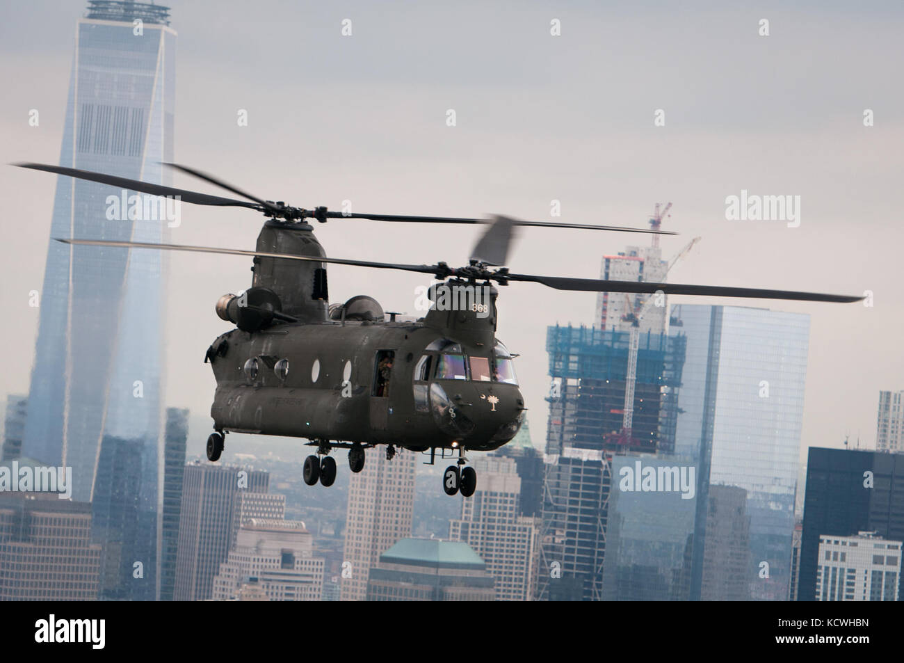 A South Carolina Army National Guard (SCARNG) CH-47D Chinook helicopter flies on the Hudson River, in front of One Stock Photo
