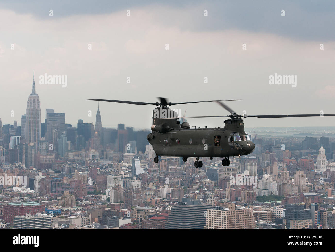 A South Carolina Army National Guard (SCARNG) CH-47D Chinook helicopter flies on the Hudson Rive, in proximity of Stock Photo