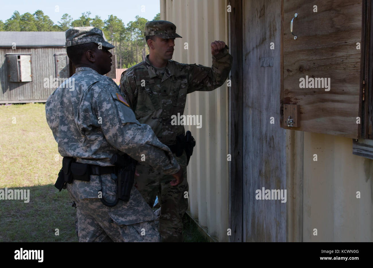 U.S. Army Spc. Jeremy Cook and partner Pvt. Damein Adams from the South Carolina Army National Guard 132nd Military - Stock Image
