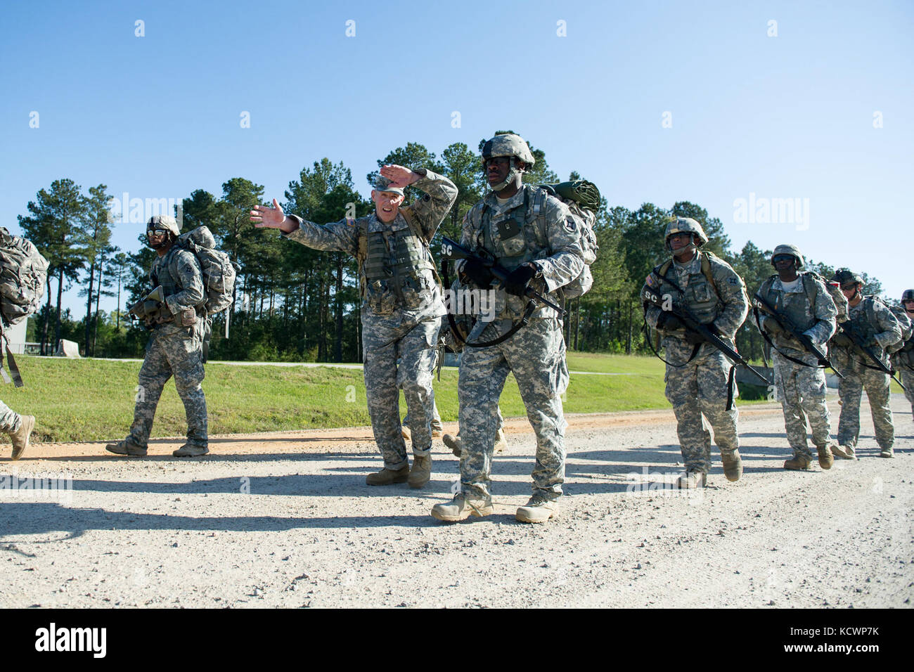 U.S. Soldiers assigned to the Florida Army National Guard conduct a 12 mile ruck march with 218th Regiment (Leadership), South Carolina Army National Guard 12 Bravo Combat Engineer instructors at McCrady Training Center, in Eastover, S.C. April 4, 2016.  The ruck march is part of the combat engineer military occupation specialty retraining for soldiers transitioning to the 12 bravo career field, this class was the first to train women going into the career field at McCrady. (U.S. Air National Guard photo by Tech. Sgt. Jorge Intriago) Stock Photo