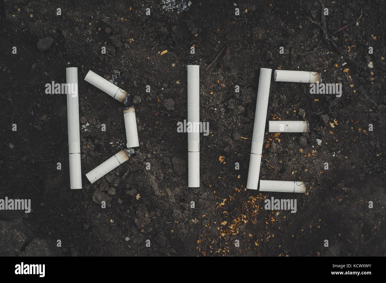 the word die written cigarettes. The dangers of Smoking. Anti tobacco a conceptual photo. - Stock Image