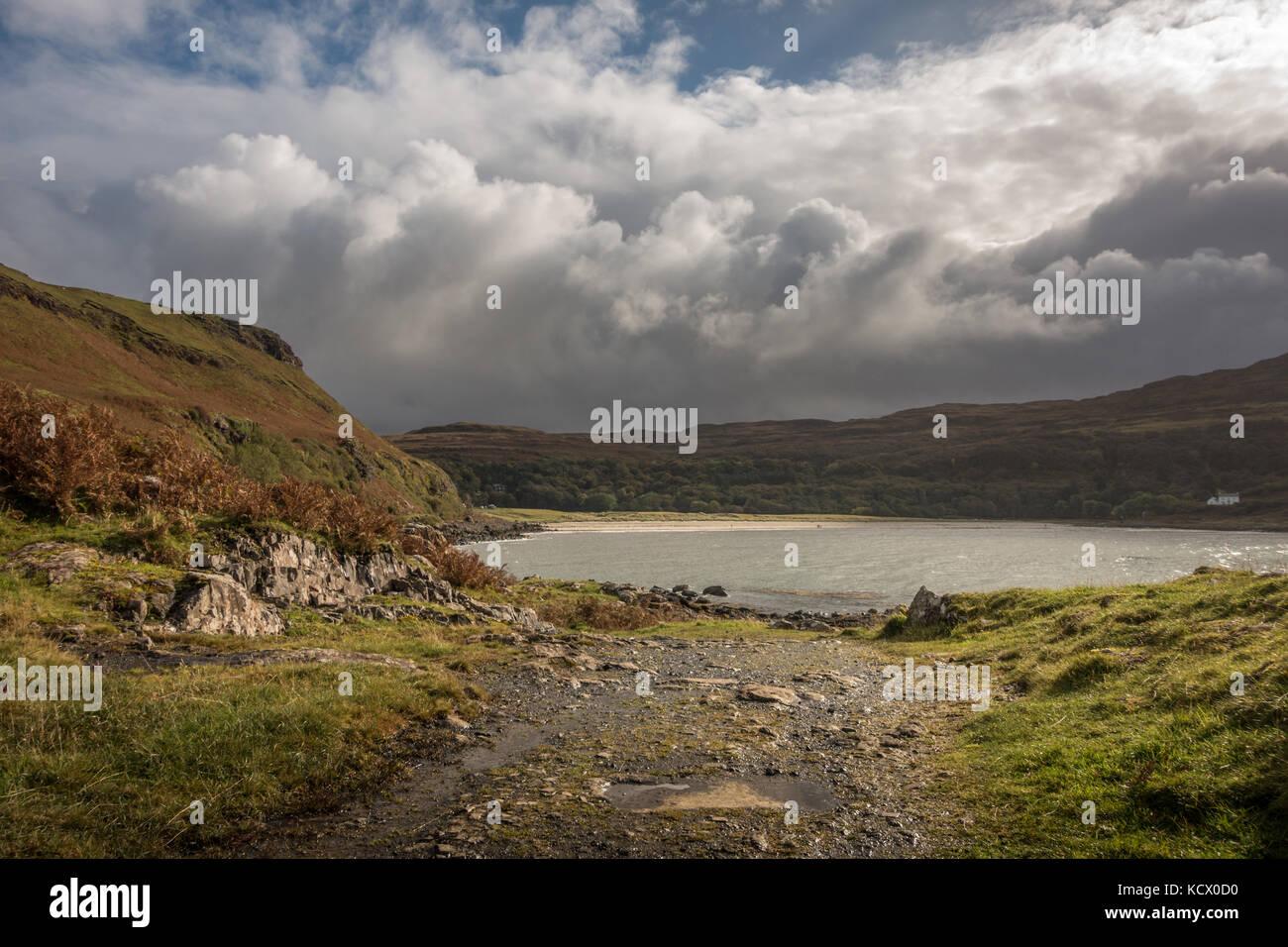 Moody sky and sunshine over Calgary Bay in autumn, Isle of Mull, Scotland - Stock Image
