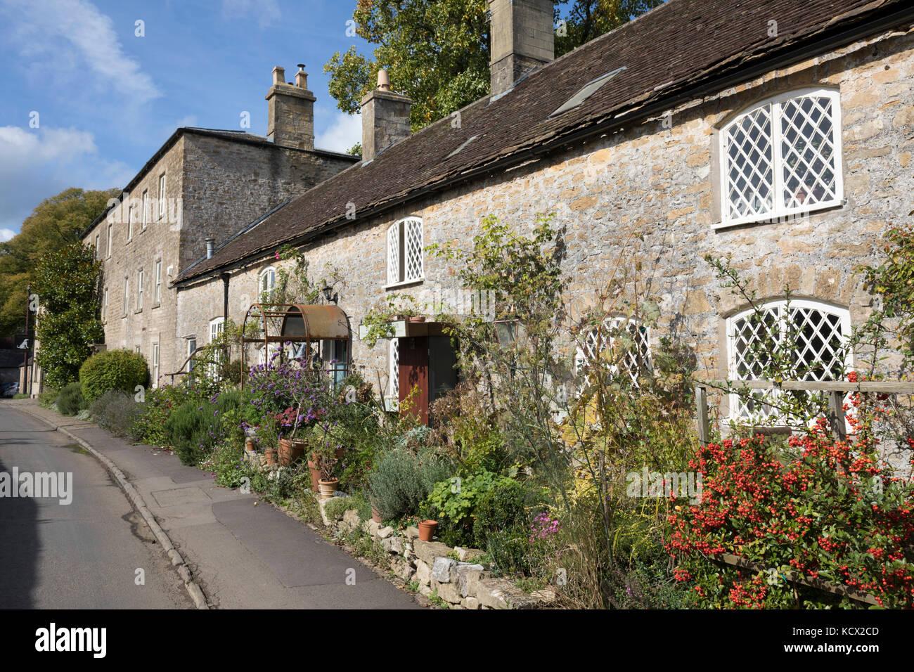 Line of traditional stone cottages, Mells, Somerset, England, United Kingdom, Europe - Stock Image