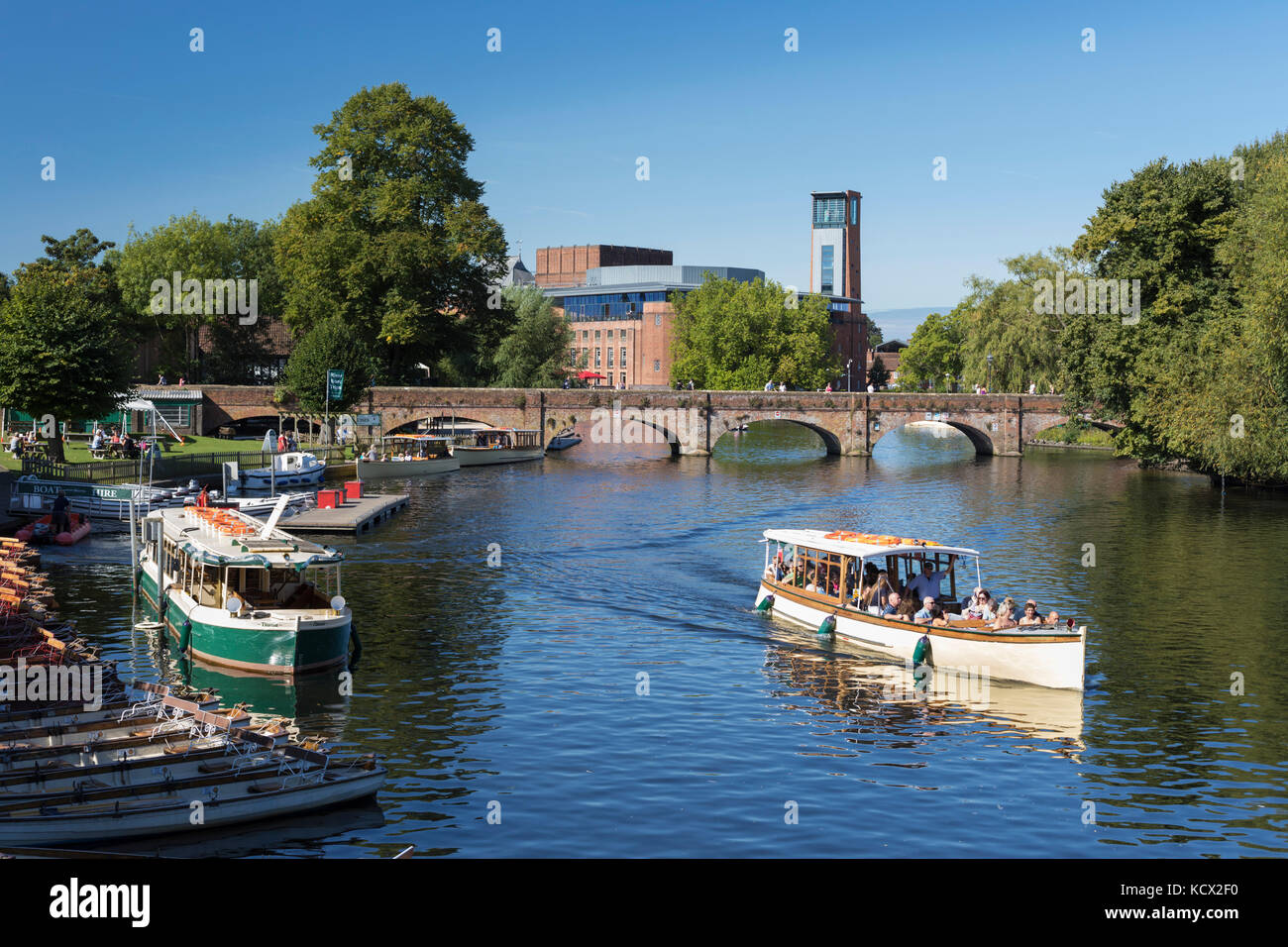 Tour boat on the River Avon with the Royal Shakespeare Theatre, Stratford-upon-Avon, Warwickshire, England, United - Stock Image