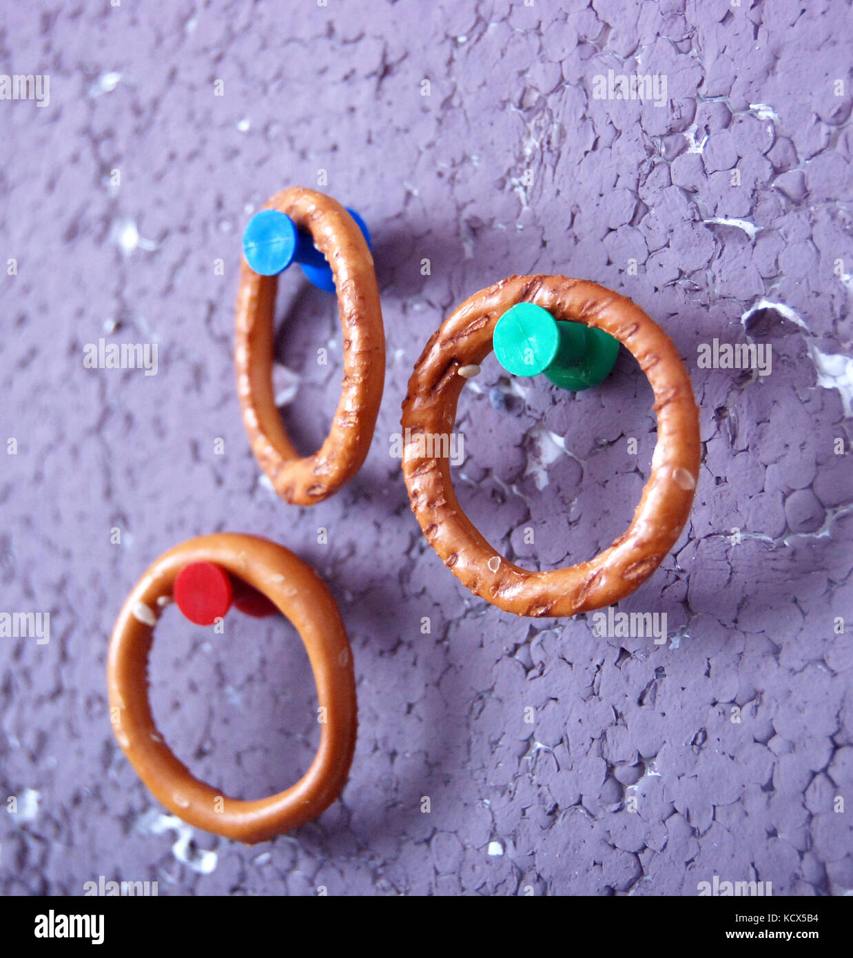 Picture of a ring crackers hanged on a pushpin - Stock Image