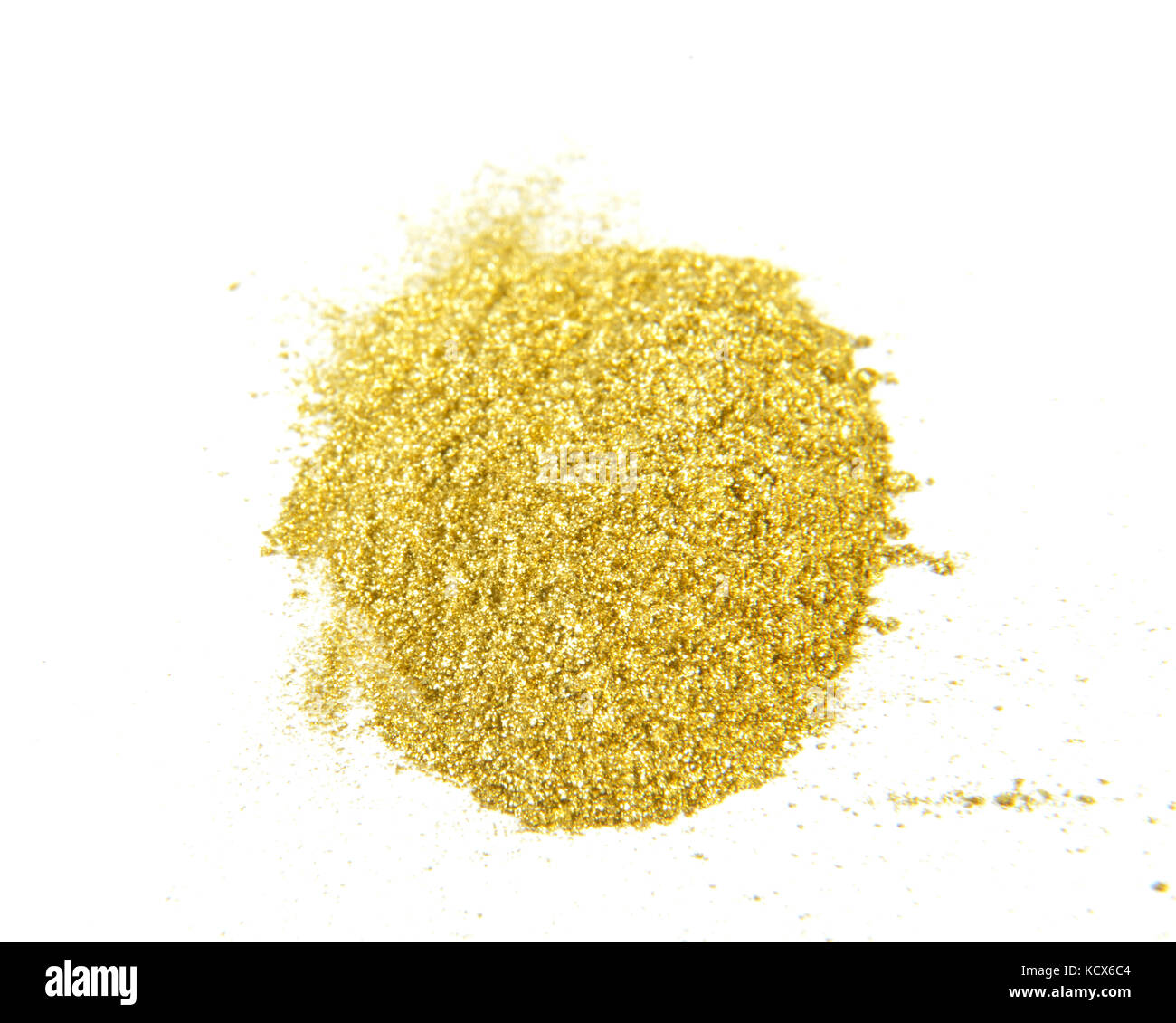 image of a gold glitter powder on white background - Stock Image
