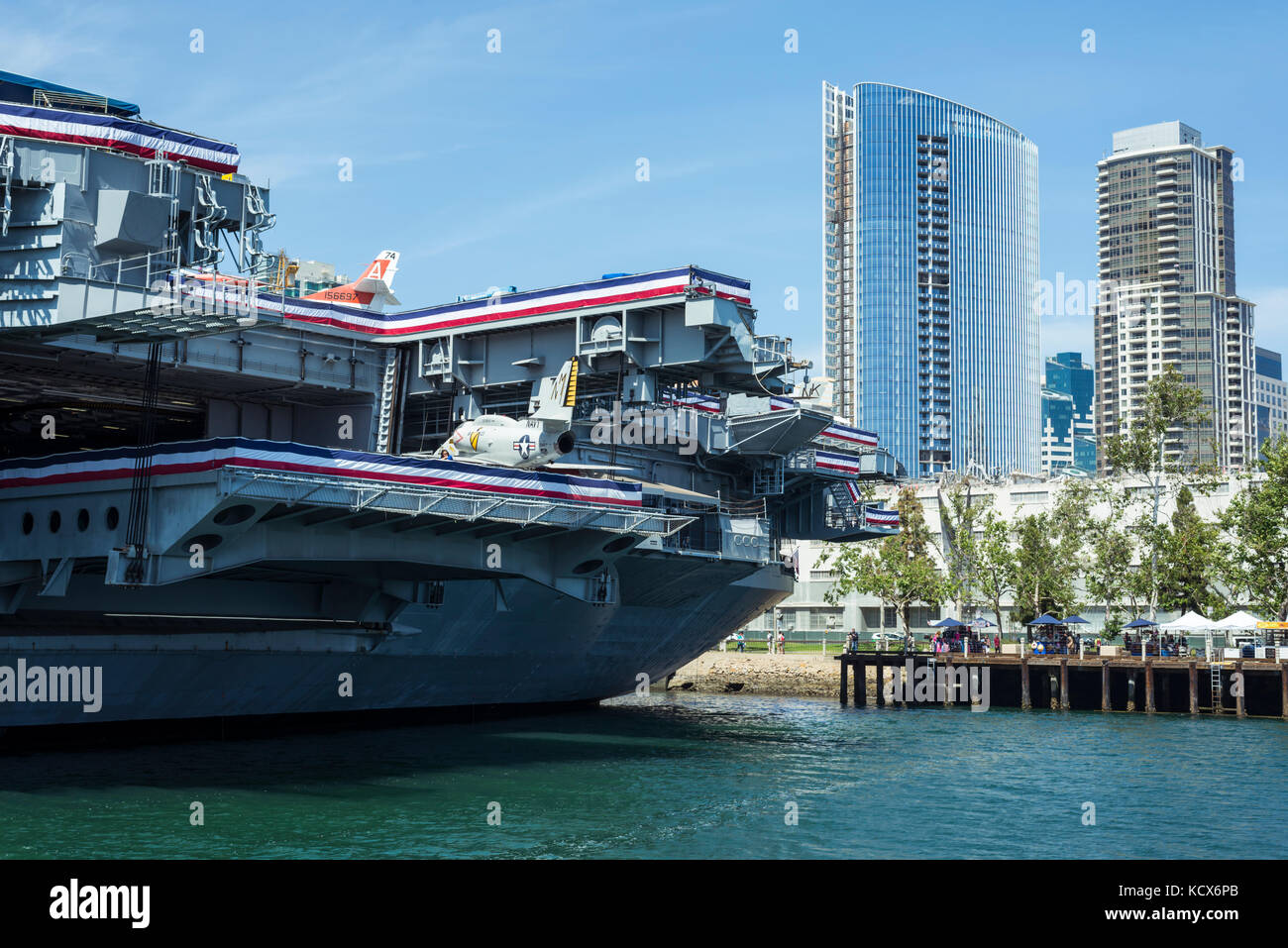The USS Midway Museum Ship and downtown San Diego buildings. San Diego, California. Stock Photo