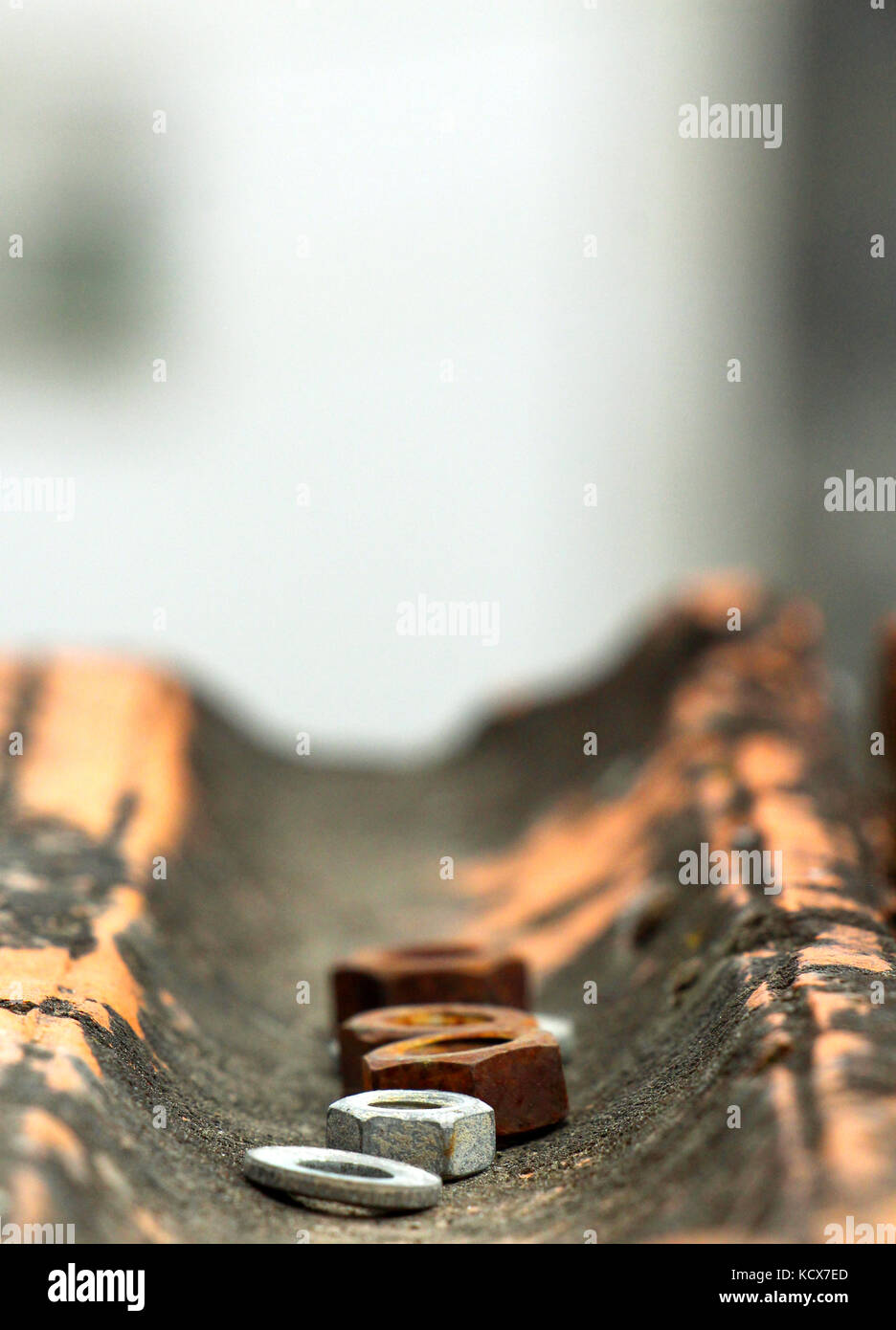 old rusty metal nuts on an old roof tile,shallow dof, Stock Photo