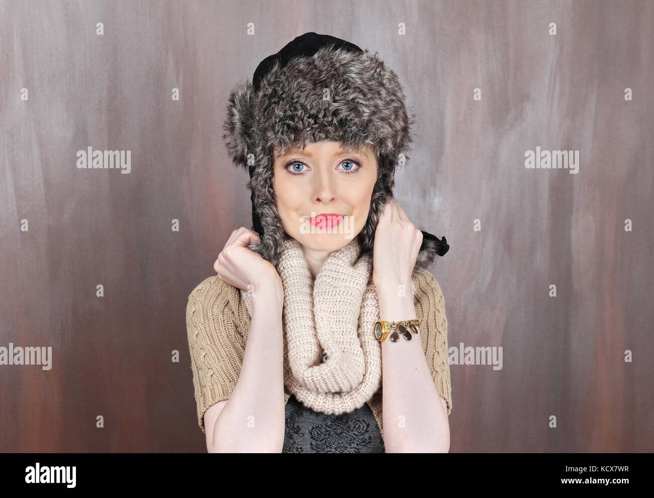 fd7422c1d0c Young beautiful blue eyed girl wearing traditional warm Russian cap with  ear flaps - Stock Image