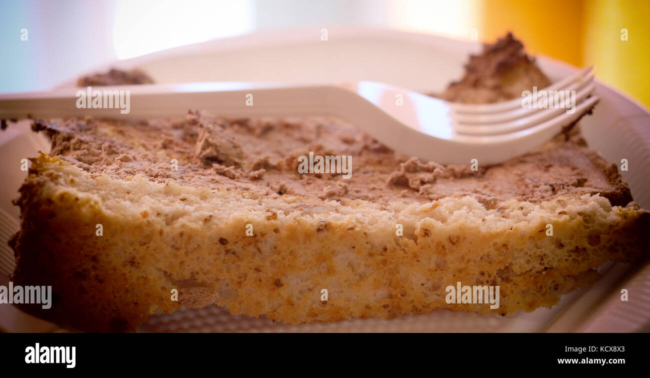 pieces of tasty cake ona a disposable plate - Stock Image